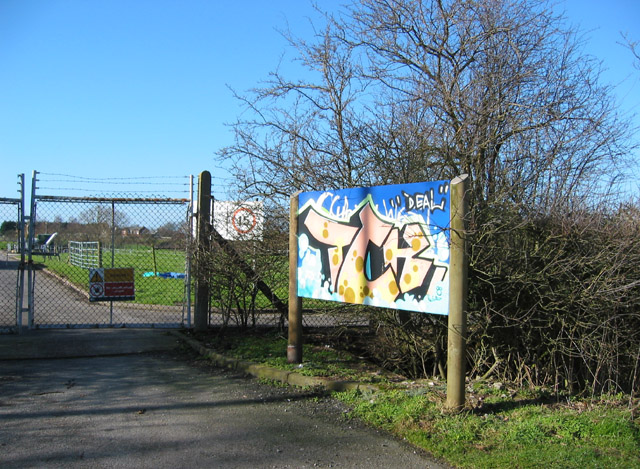 Colourful graffiti on sewage works sign