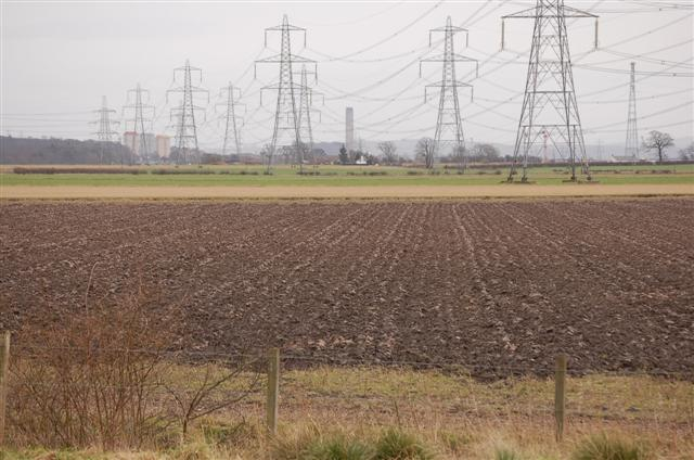 Ploughed field and pylons