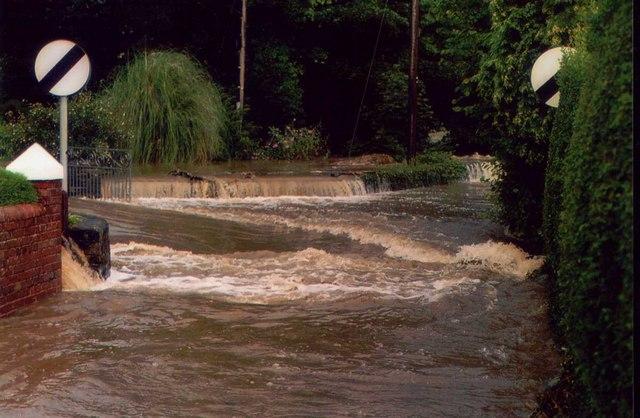 Afon Wen in flood across Glanywern Chwilog