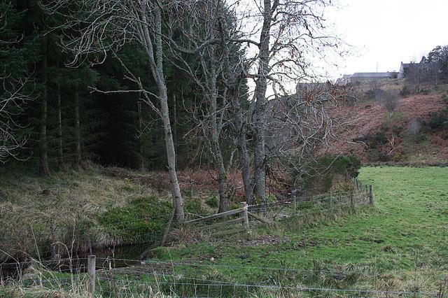 Upstream on the Black Burn with Blackhillocks Farm on the hill.