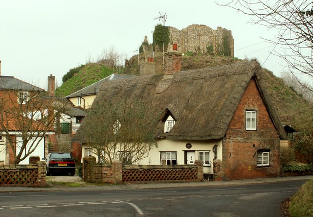 Thatched cottage with Eye Castle behind