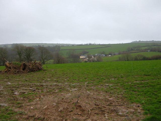 View across farmland to farm