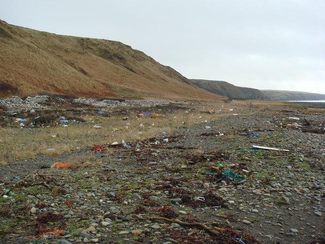 Desolate plastic-strewn raised beach