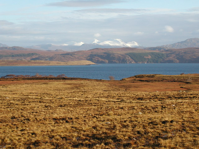 The southern shore of Isle of Ewe beneath snow-capped An Teallach