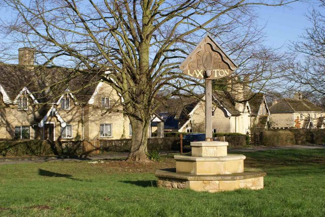 Village sign and estate houses at Laxton