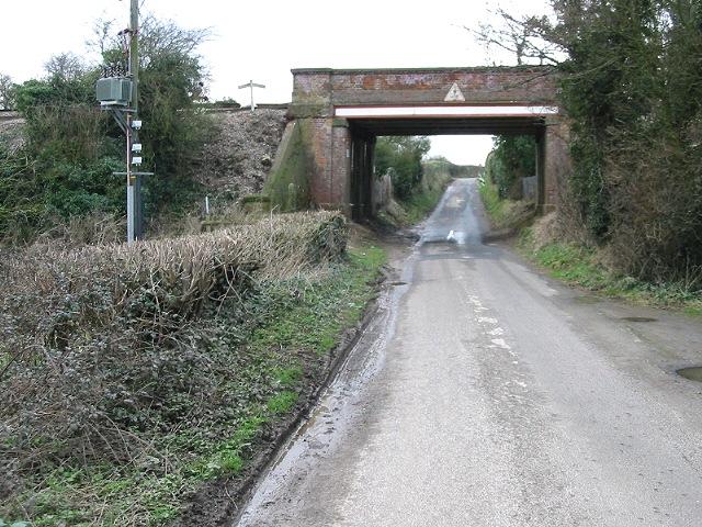 Railway bridge over the road to East Langdon
