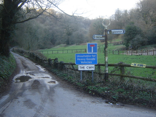 Road signs and road to The Cwm