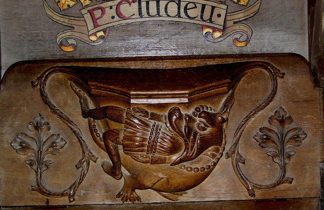 Misericord in the choir stalls of St. David's cathedral.