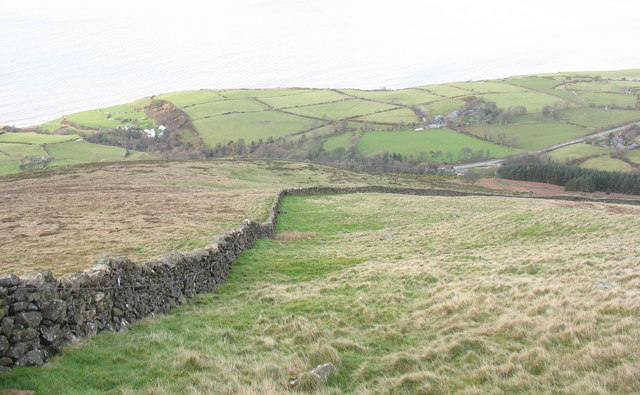 Looking downslope to the sharp bend in the boundary wall