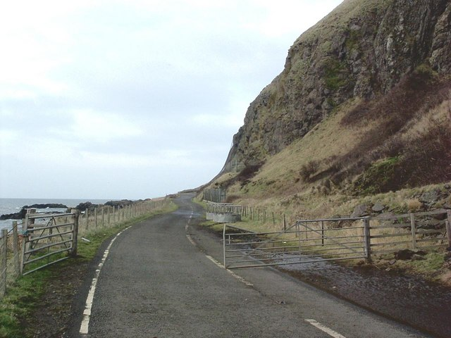 Defunct main Ballantrae- Girvan rd (A77) showing present use as winter cattle feed station