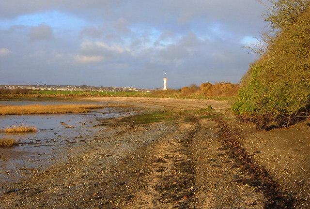 View across Beach towards beacon at Sango Point