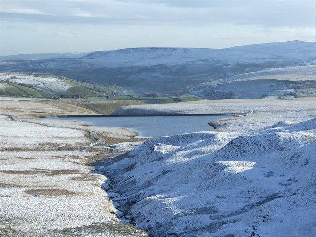 March Haig reservoir with Marsden in the distant  valley