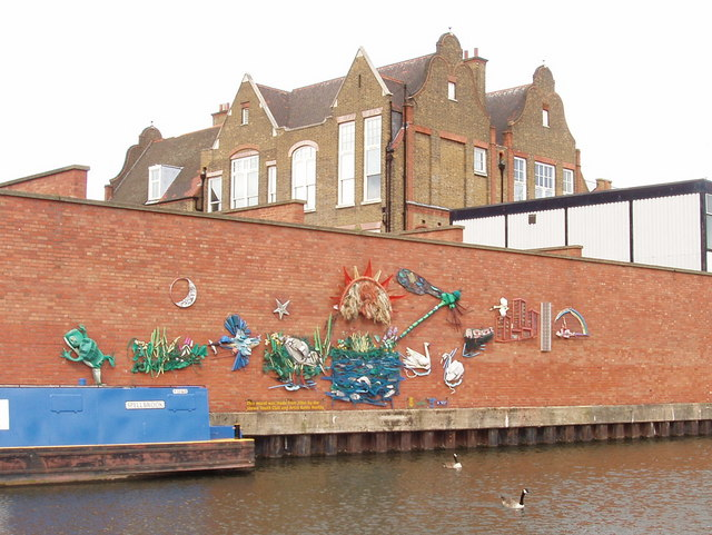Canalside mural from litter