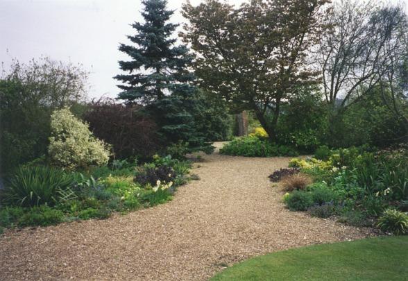 Gravel path winding through Denmans Garden, Fontwell