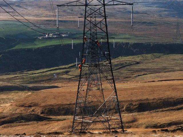 Workmen Repairing Pylons Above Light Hazzles Clough.