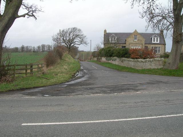 Minor road junction & cottage off B6461