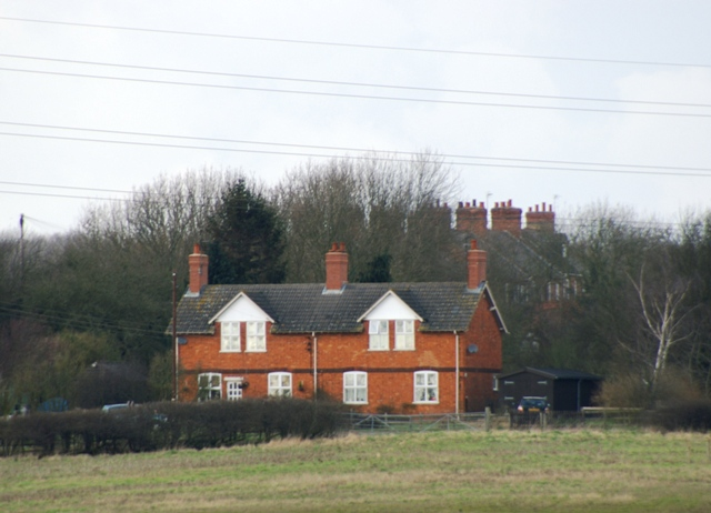 Cottages close to A6003 junction with the Newton road