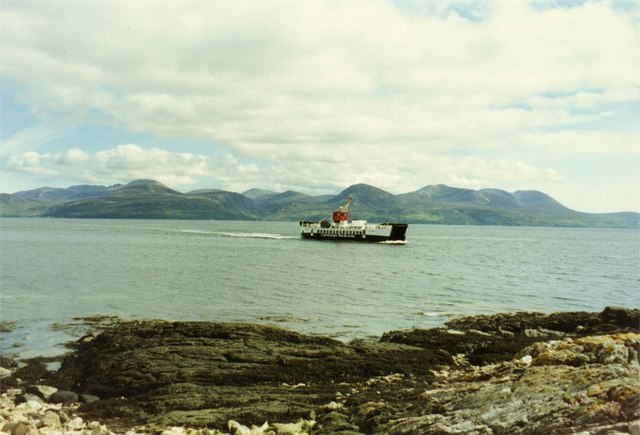 Rocky foreshore on Sound of  Bute, with Arran and ferry in background