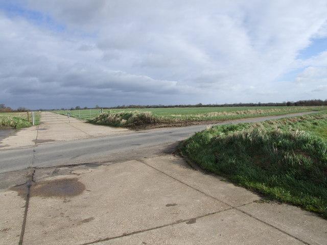 Road crossing disused part of Tibenham Airfield