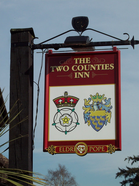 Sign for the Two Counties Inn, Rake