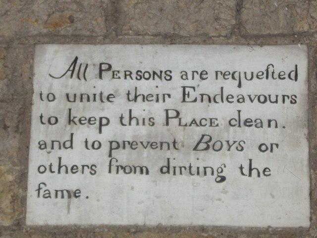 Old stone sign under the town hall.