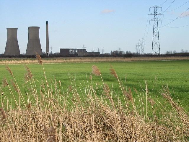 Farmland under the shadow of pylons
