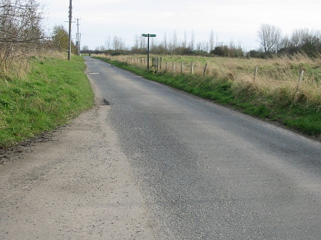 Saxon Shore Way footpath crossing a minor road.