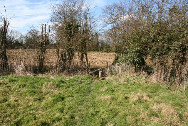 Footpath over stile and into ploughed field, Tudeley Hale, Kent