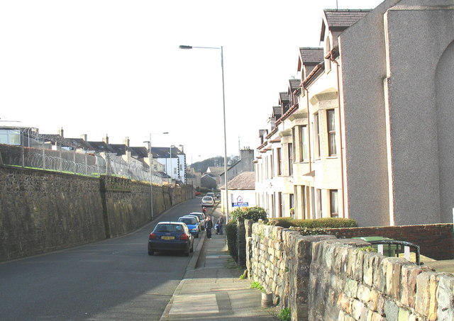Beneath the barrack wall