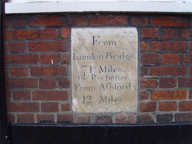 Milestone on front of The Swan Public House in the High Street.