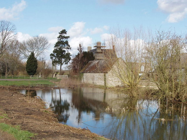 Middle farm buildings reflected in pond