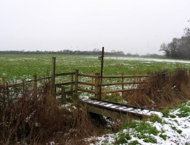Footbridge, stile and fields