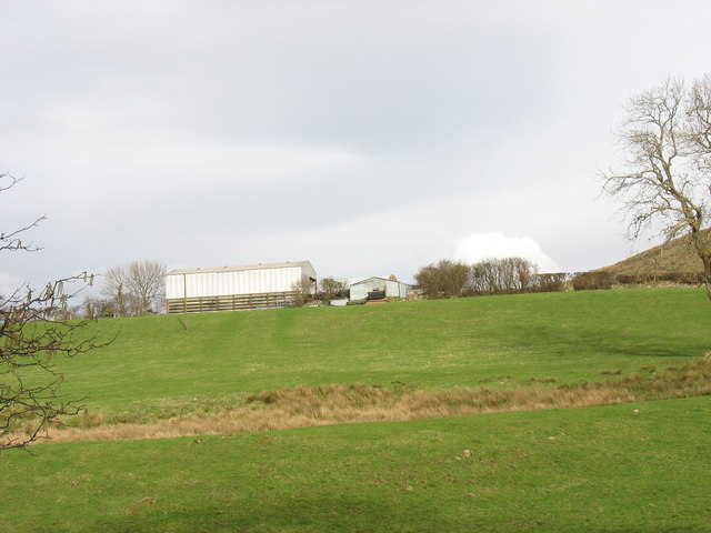 Farm buildings at Hendre Bach viewed from Pont Faen bridge