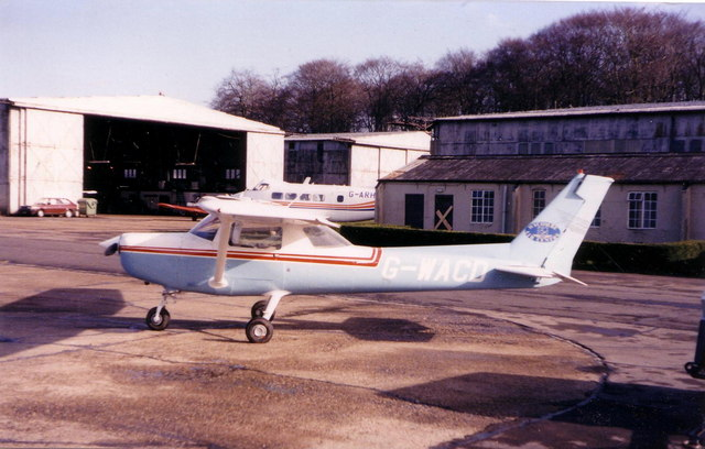 Aircraft and hangars at Wycombe Air Park