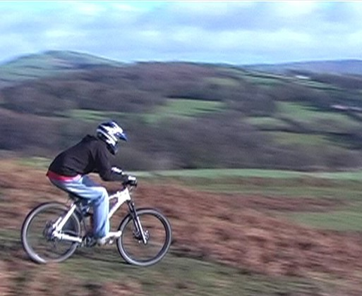 Mountain biker on the Golf Links above Rhayader