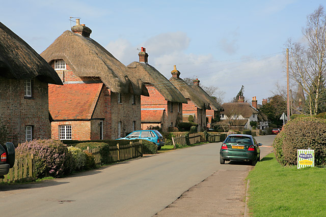 Five identical thatched cottages in East Stratton