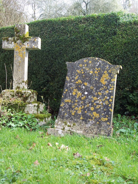 Gravestone and cross in St Marys Churchyard
