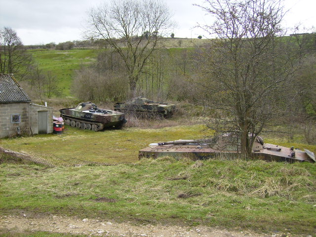 Old army tanks in disused part of quarry at Wath