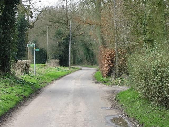 Footpath crossing road near Snodehill Farm