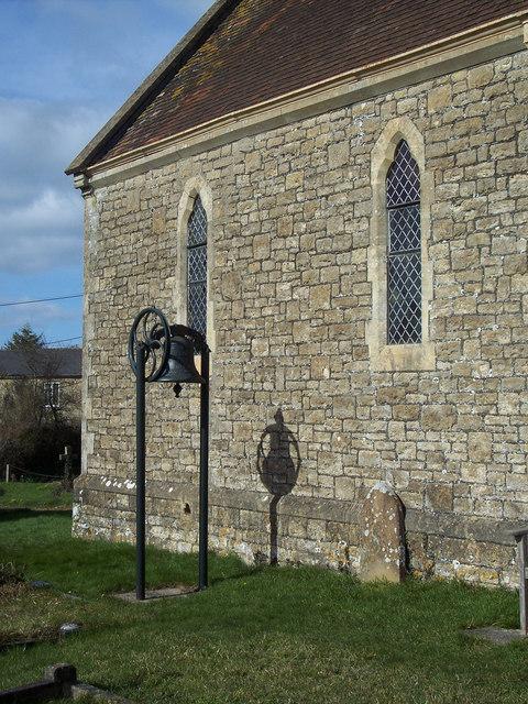 Bell in churchyard, All Saints Church