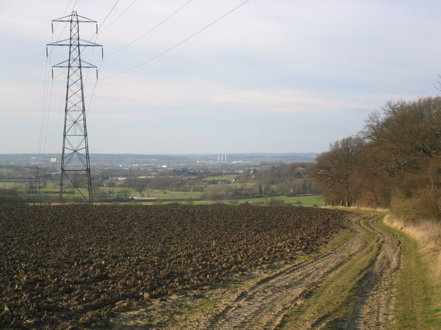 Ploughed field and pylon, with view over to the Lea Valley
