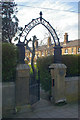 Dist:0.2km<br/>Entrance Gate to St Pancras Almshouses, with dwellings in the background. Mid-19th century.