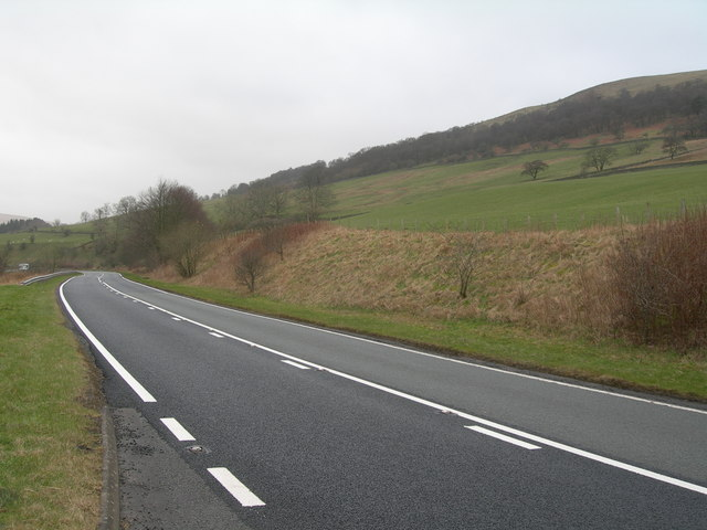 Bend on A7 & slopes of Castle Hill
