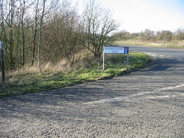 Junction of Wickham Bushes Road with Lydden Hill