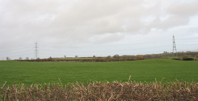 View north across pasture land towards the Wylfa power line