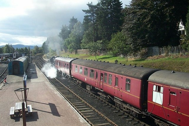 Boat of Garten - steam train pulling out of the station towards Aviemore