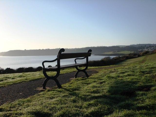 Metal bench, looking out to sea below Sugar Loaf