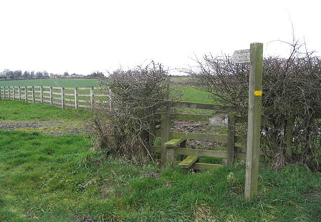 Public footpath sign and stile