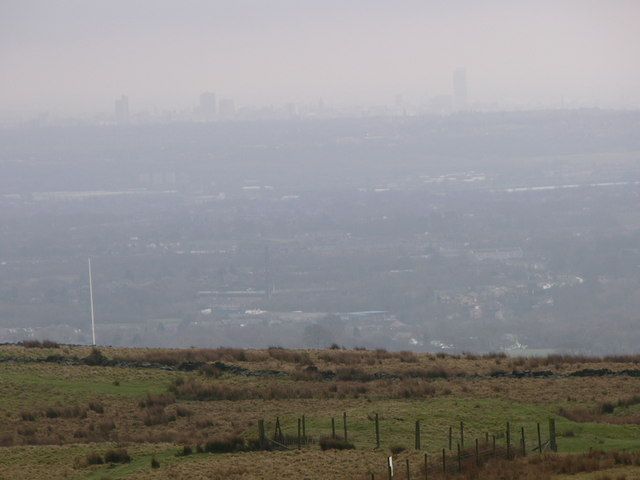 Flagpole on Lark Hill with  Manchester behind