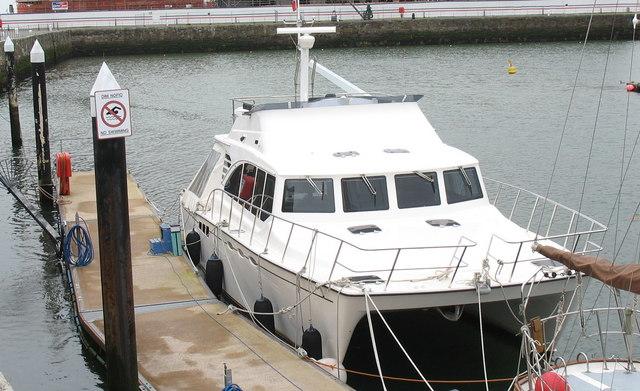 Boat accessing pontoon at the Marina
